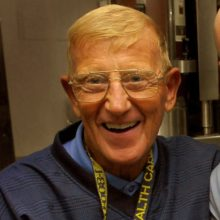 070725-N-4166B-005 PACIFIC OCEAN (25 July, 2007) - Legendary NCAA Football Coach Lou Holtz poses for a photo with Storekeeper 3rd Class (SW) Eric Davidson after signing a football for Davidson's father.  Holtz, also a best-selling author and motivational speaker, visited Nimitz-class aircraft carrier USS Abraham Lincoln (CVN 72) at sea July 24-25 to tour the ship and meet Lincoln's crew. Photo by Mass Communication Specialist 2nd Class Jordon Beesley. (RELEASED)