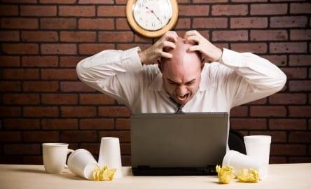 frustrated-worker-at-desk