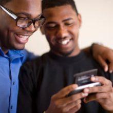 Two men using PDA