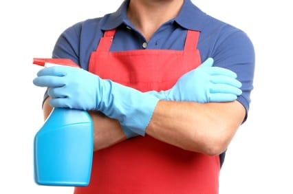 man in red apron with sprayer